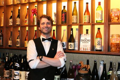 Christopher Pellegrini hosting guests on a Maction Planet Tokyo Shochu Tour