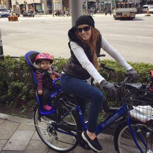 Maction Plnaet interviewee Hillary Barnette and daughter cycling around Tokyo