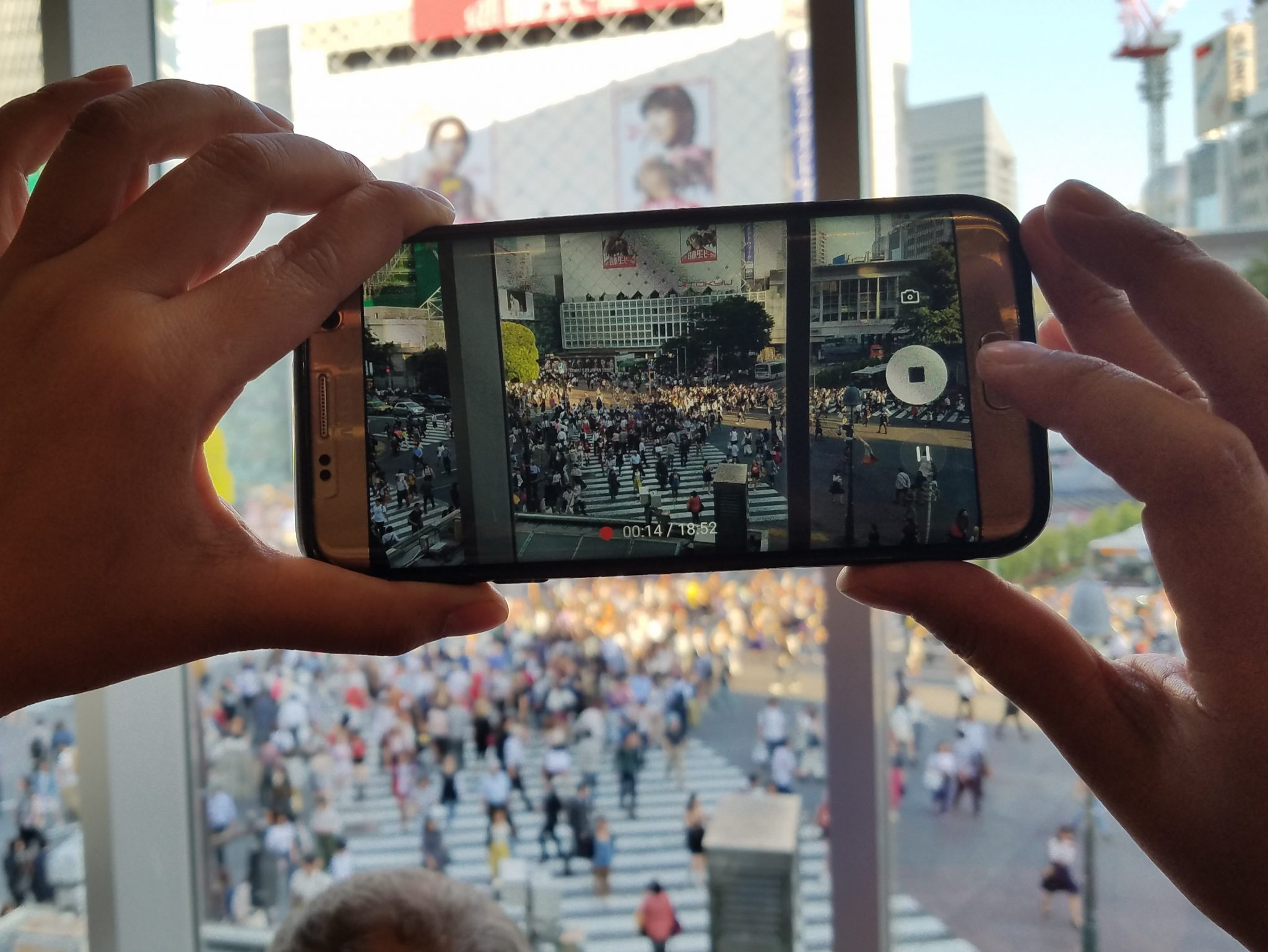 Shibuya Crossing picture-in-picture seen on a Maction Planet Tokyo Private Tour