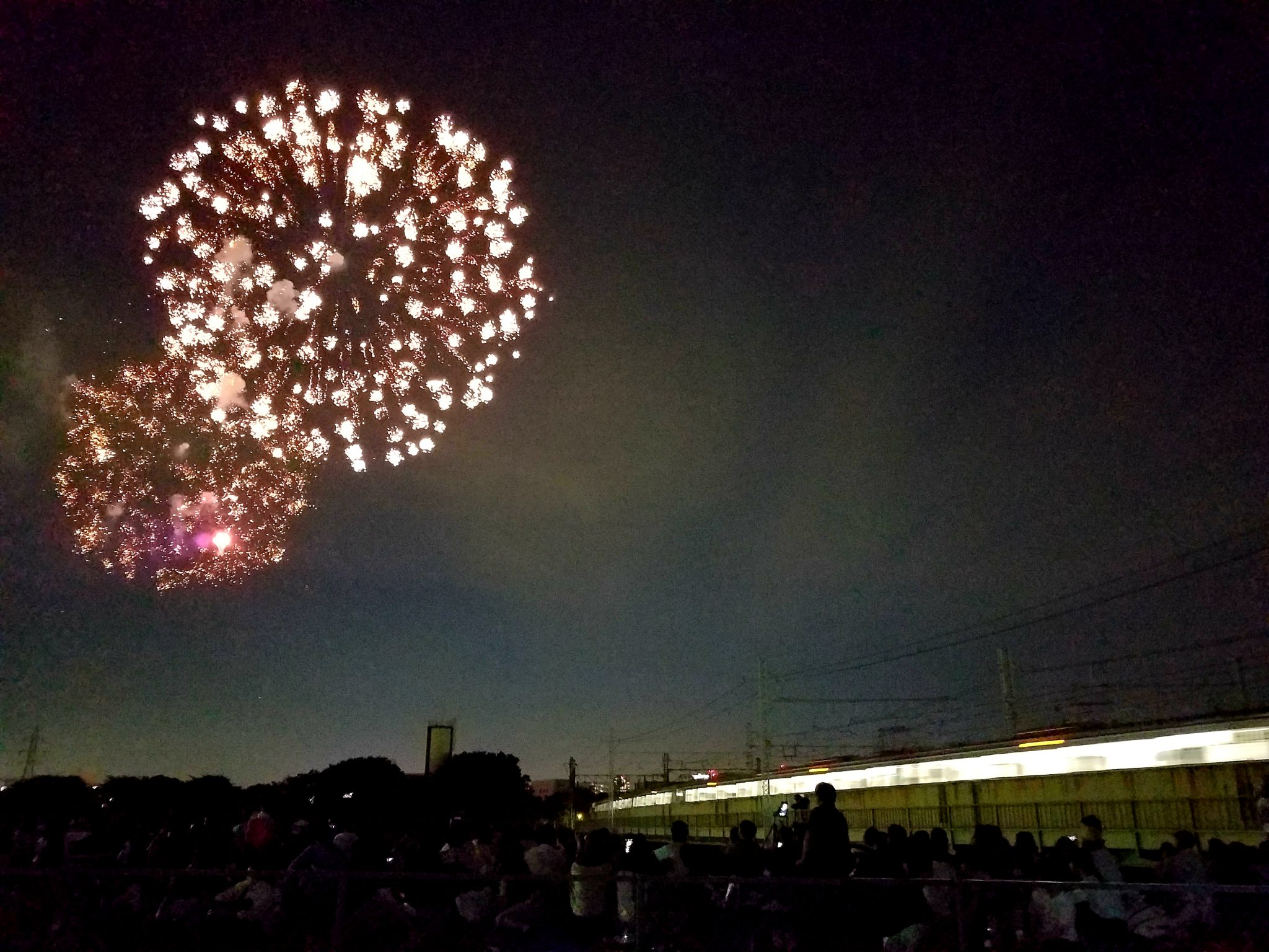 Tsurumi Fireworks 2018 with train seen on a Maction Planet Tokyo Private Tour