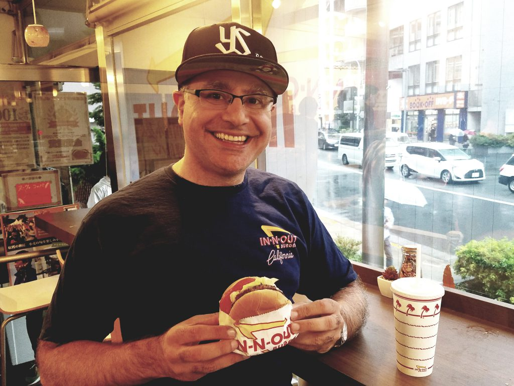 Mac, Founder and Lead Guide of Maction Planet, with an In-N-Out Double-Double during their 2018 Tokyo Pop-Up