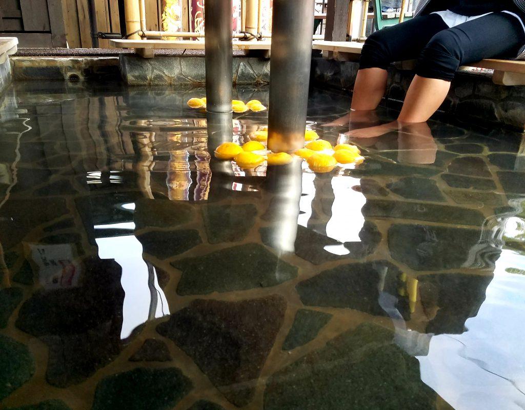 Yuzu-filled ashiyu footbath at Randen Arashiyama Station