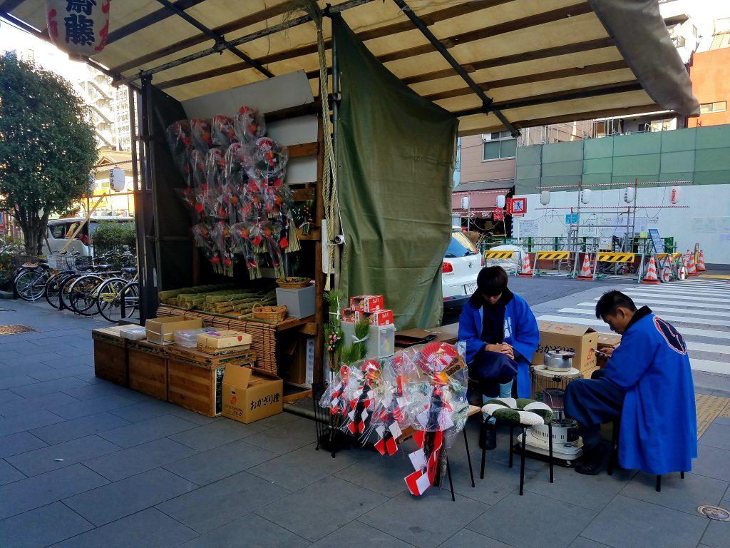Selling wreaths near Ningyocho station