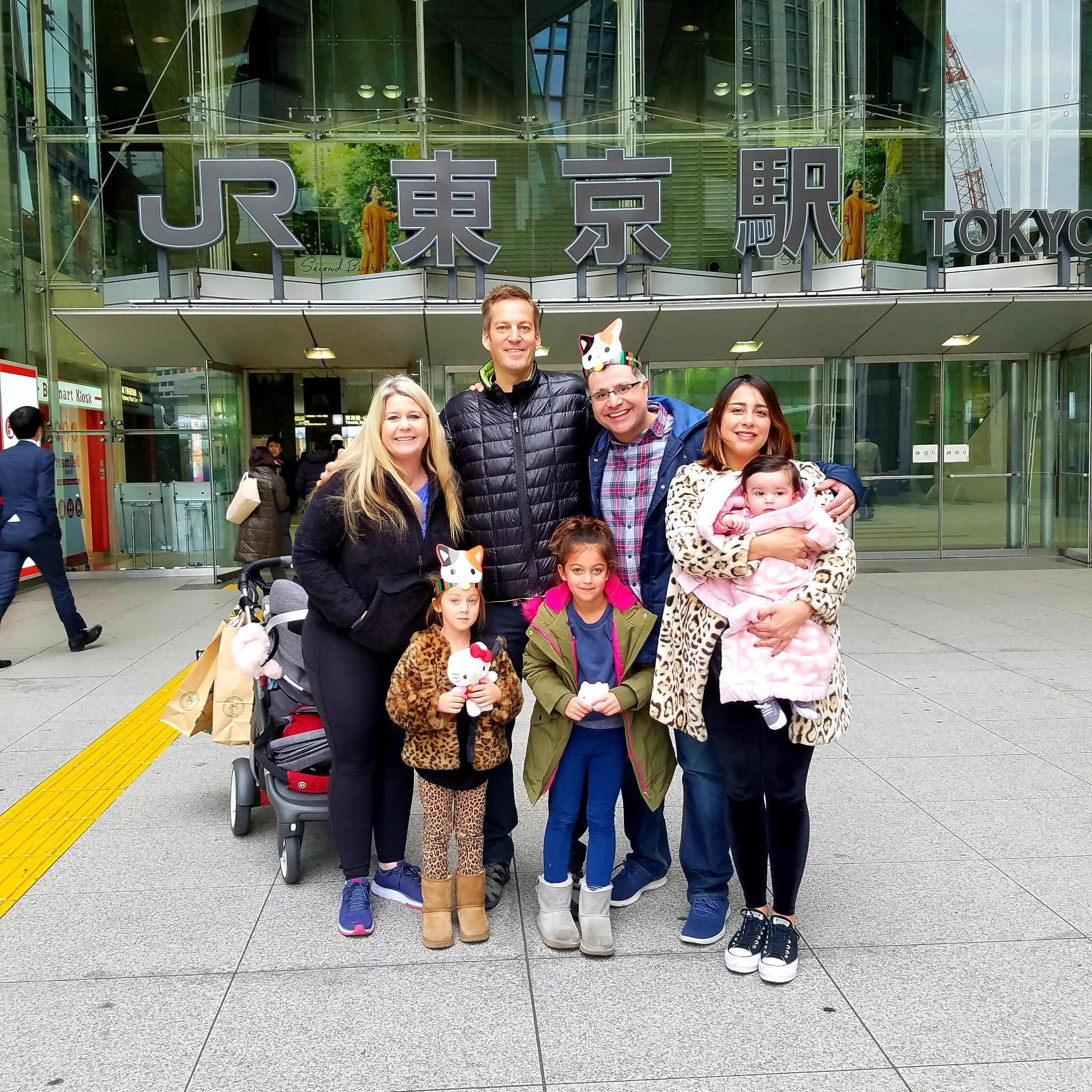 Mac, Founder and Lead Guide of Maction Planet, with the Baker Family outside Tokyo Station