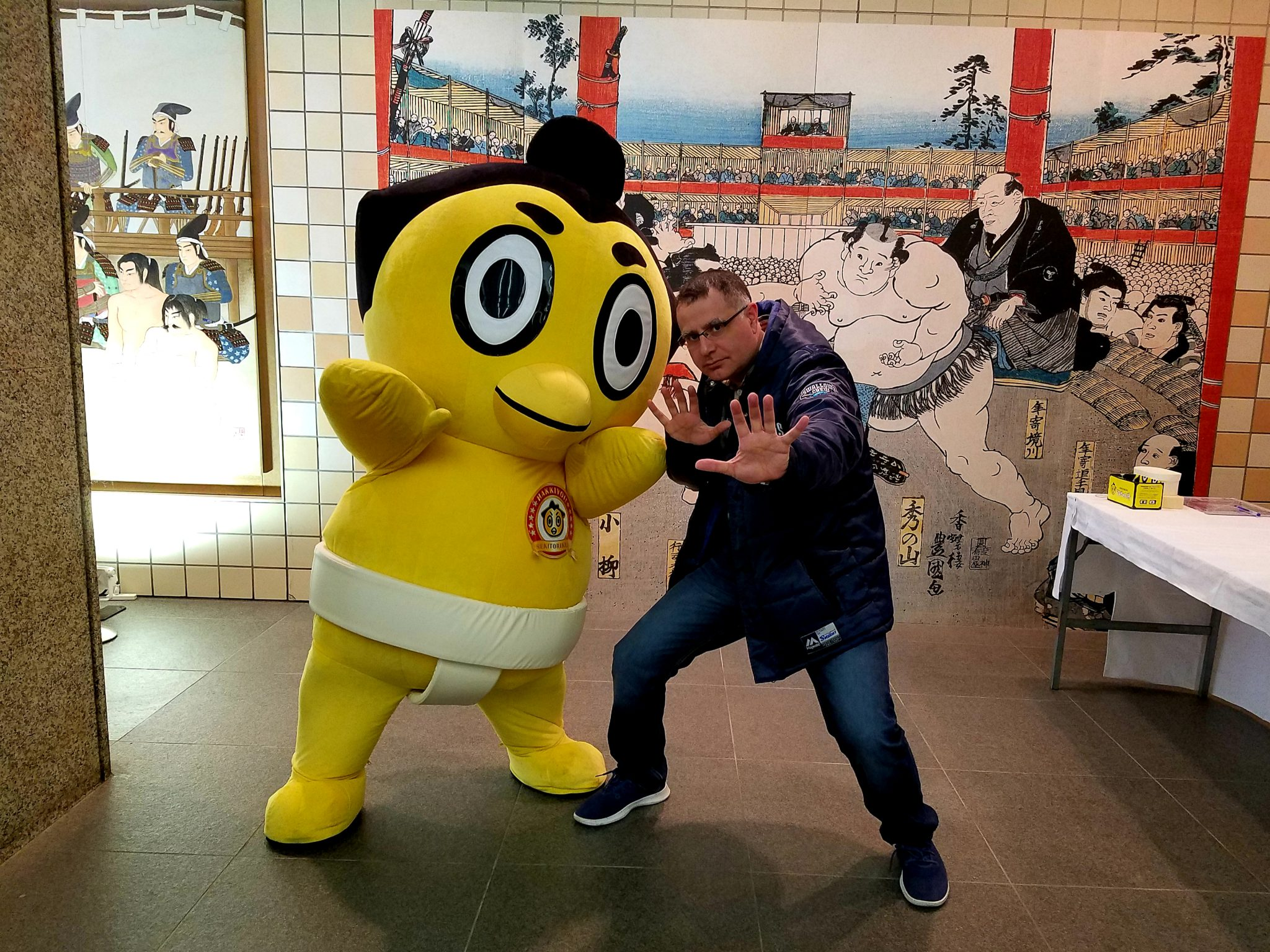Mac, Founder and Lead Guide of Maction Planet and Hiyonoyama, sumo mascot