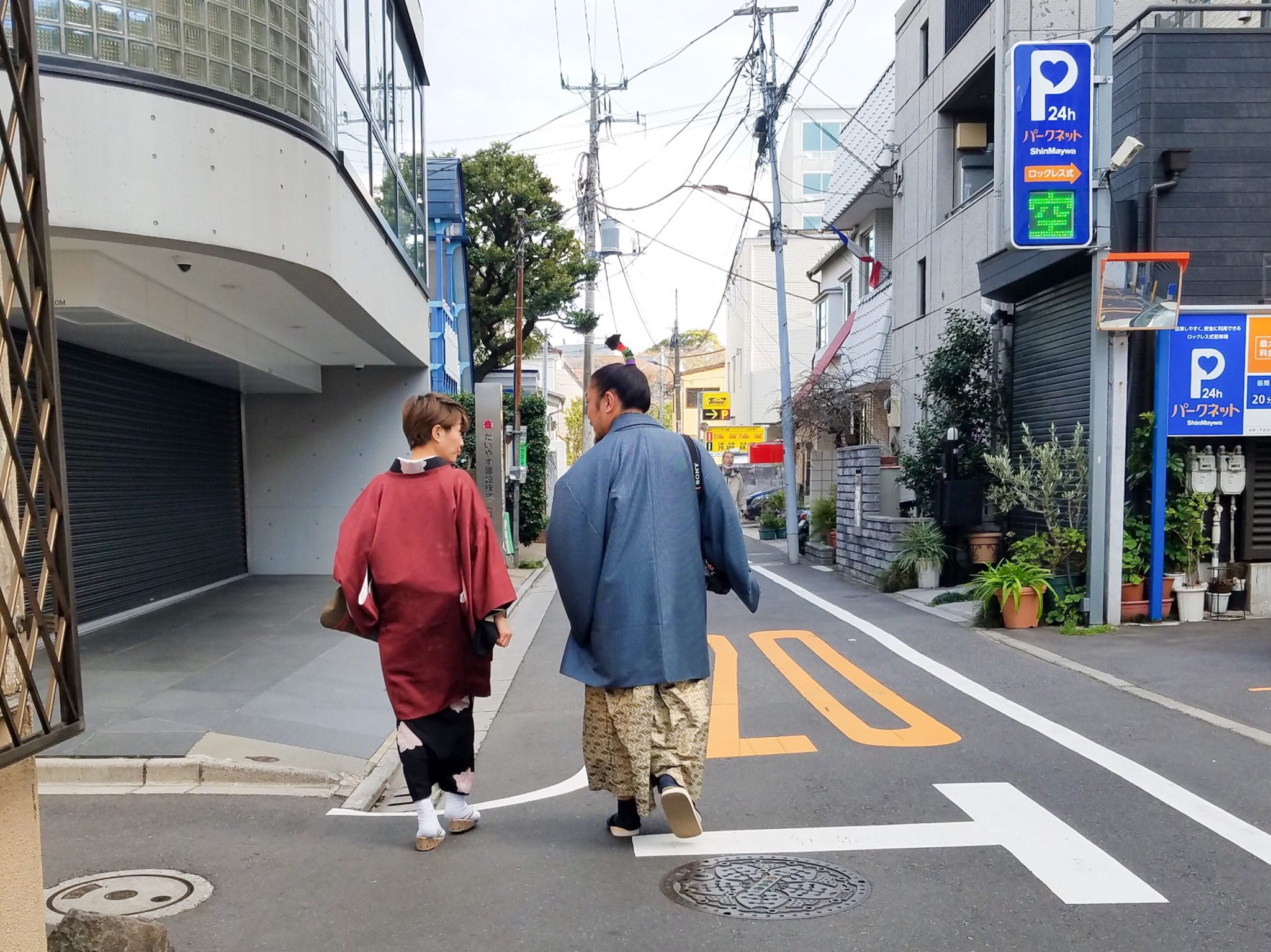 Edo Boulevardier: Tokyo locals in traditional dress walking toward Tokyo University of the Arts