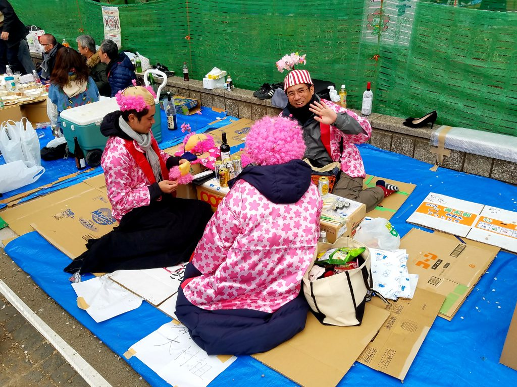 Revellers enjoying hanami at Ueno Park in Tokyo