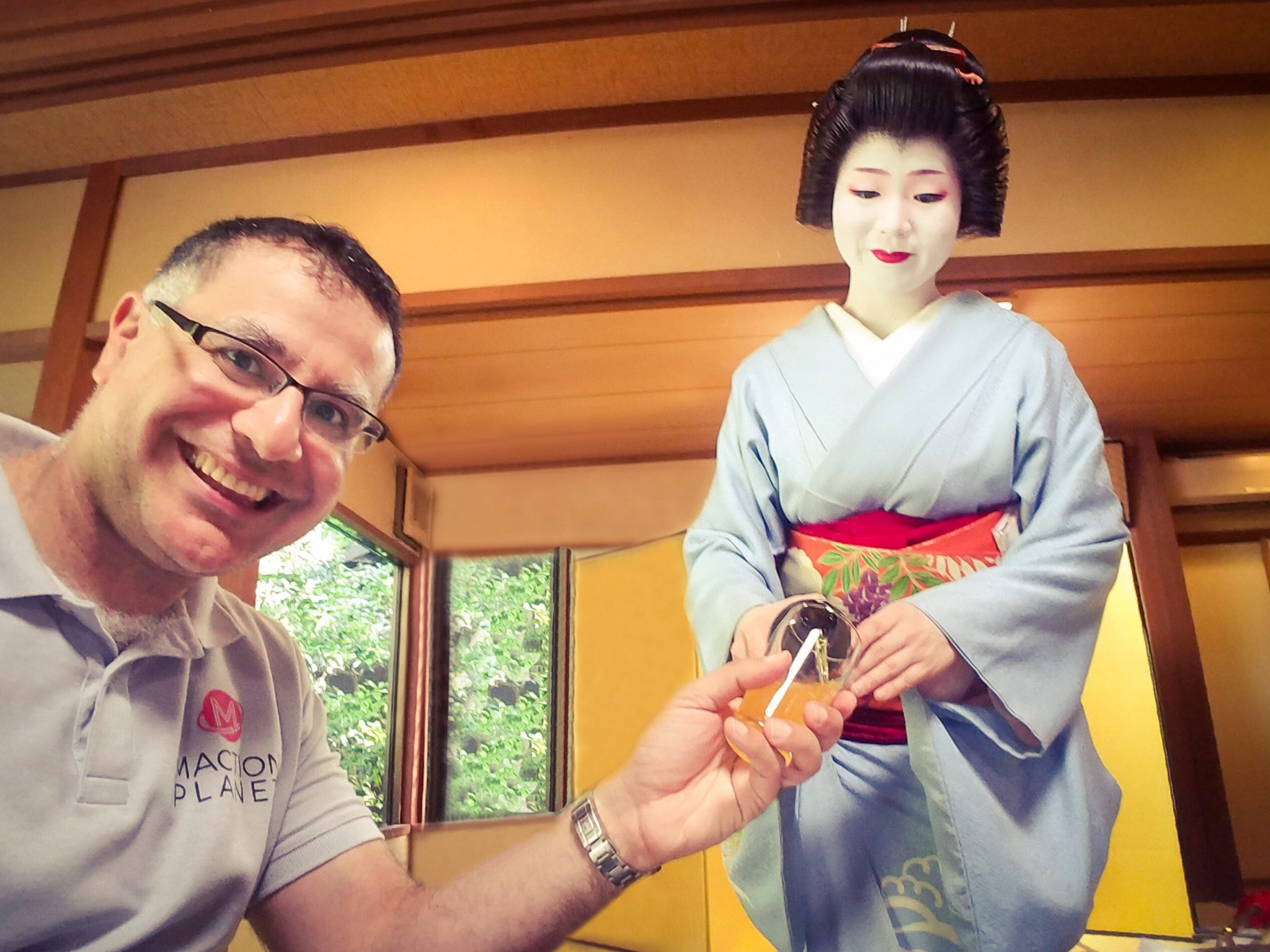Mac, Founder and Lead Guide of Maction Planet, drinking with a geisha in Gion, Kyoto