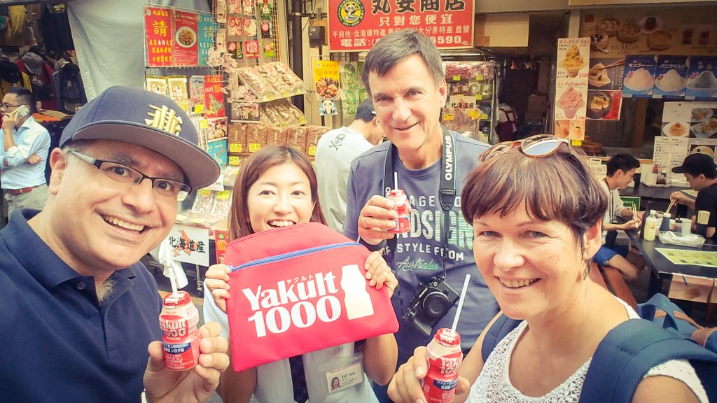 Mac, Founder and Lead Guide of Maction Planet Tokyo Private Tours with guests and Yakult vendor