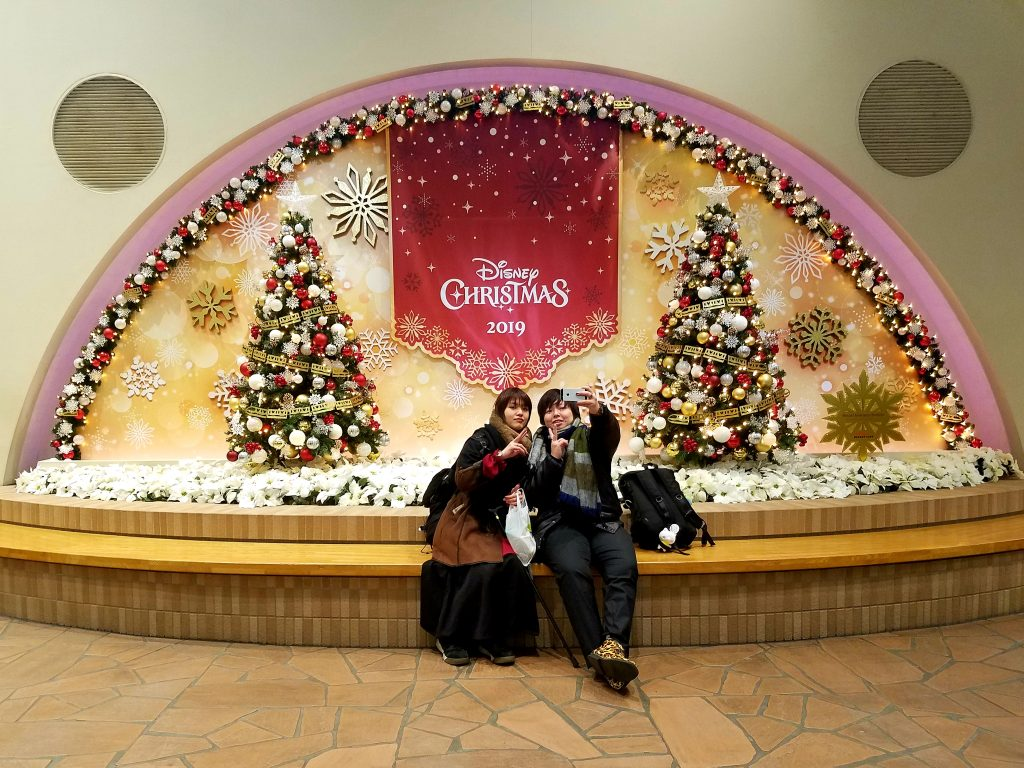 Girls enjoying Christmas at Tokyo Disneyland