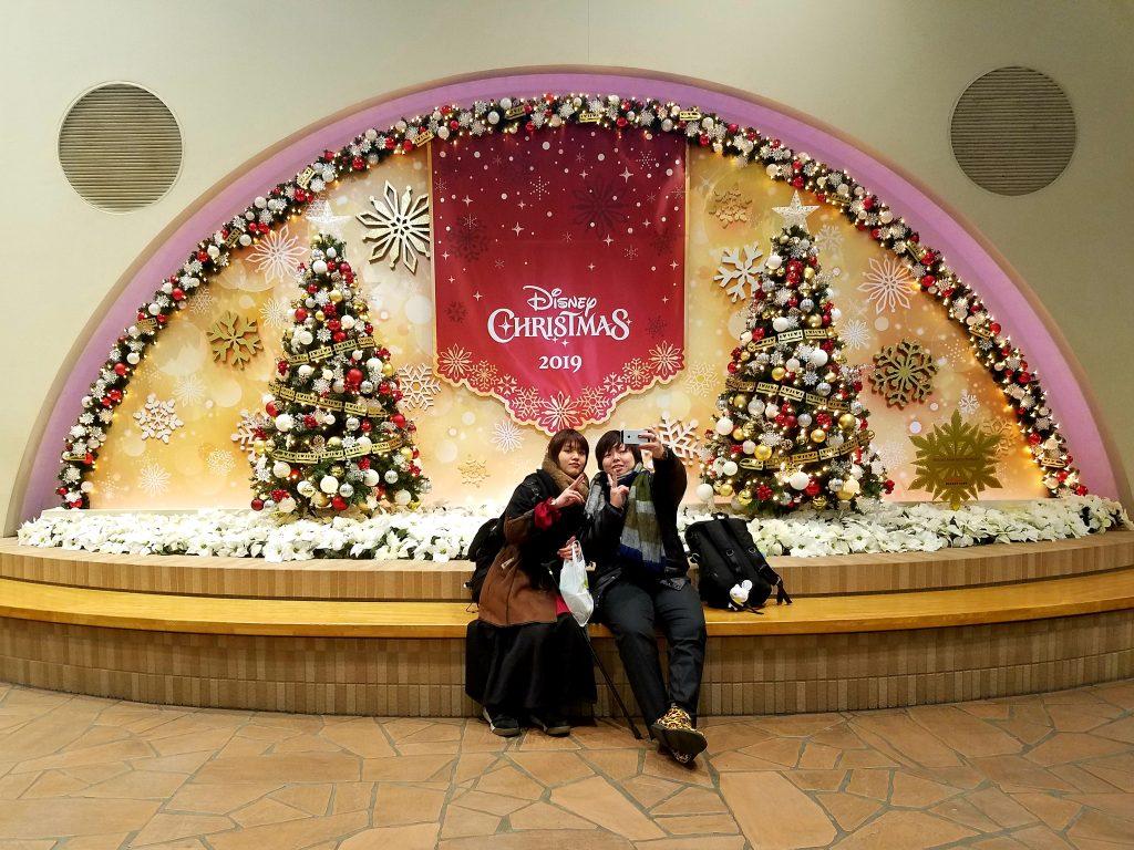 Girls enjoying Christmas at Tokyo Disneyland