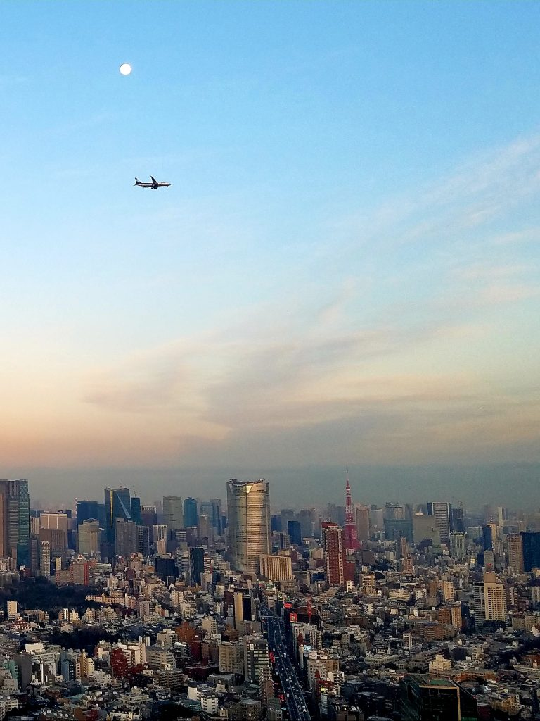 Plane flying over Tokyo on Friday 7 February as part of new Haneda Airport flight path trials