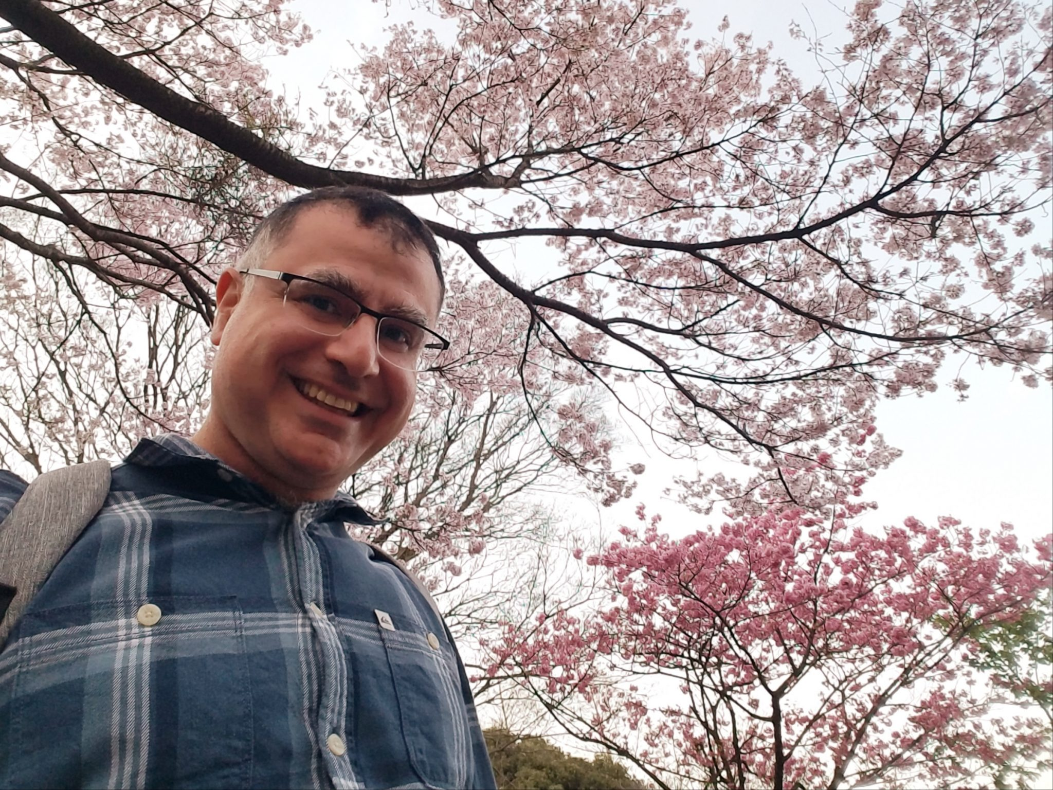 Mac, Founder and Lead Guide of Maction Planet Japan Private Tours, under Sakura in Mitsuike Park, Kanagawa