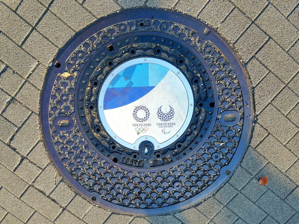 Tokyo 2020 Olympic and Paralympic manhole cover in Shinobazu Pond, Ueno Park