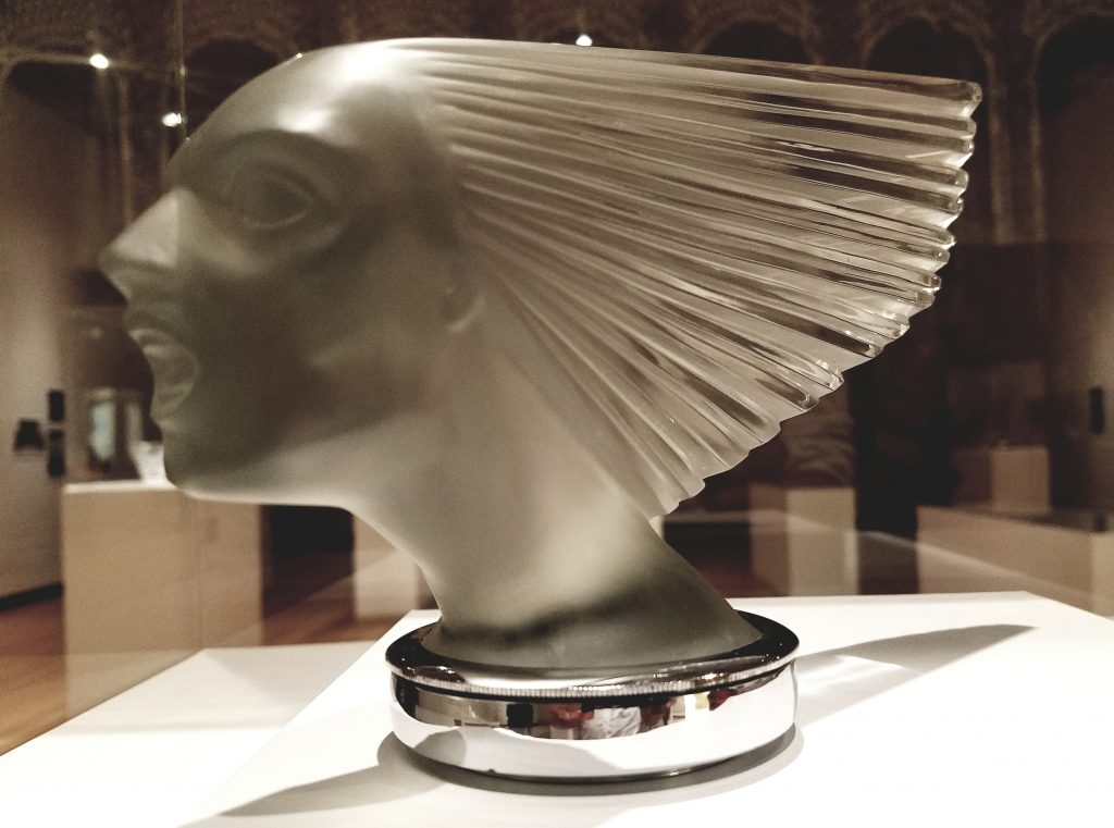 'Rene Lalique - Modernity and Elegance' at the Tokyo Metropolitan Teien Art Museum: Automotive Mascot Victory (1928) Mold-blown clear glass, satine [Nabesima Houkoukai Foundation]