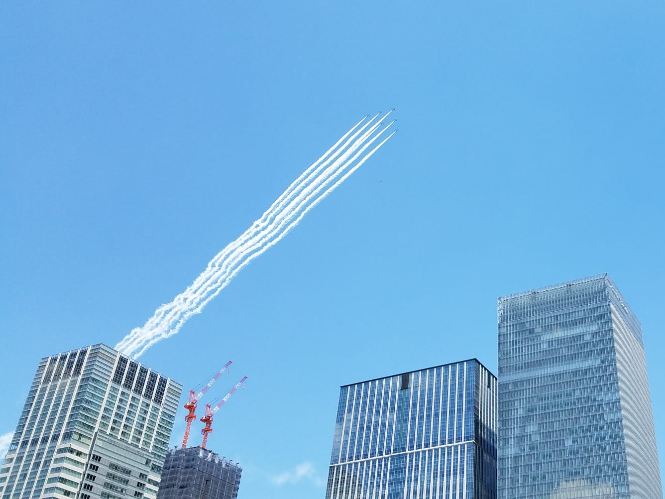 Blue Impulse (ブルーインパルス, Burū Inparusu), the aerobatic demonstration team of the Japan Air Self-Defense Force (JASDF), flies over Tokyo on 29 May 2020 to thank healthcare workers fighting the novel coronavirus COVID-19