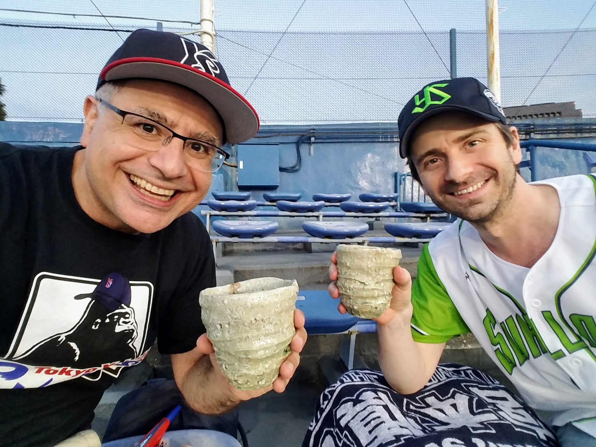 Christopher Pellegrini and Mac, Founder and Lead Guide of Maction Planet Bespoke Japan Travel, drink shochu at Jingu Stadium