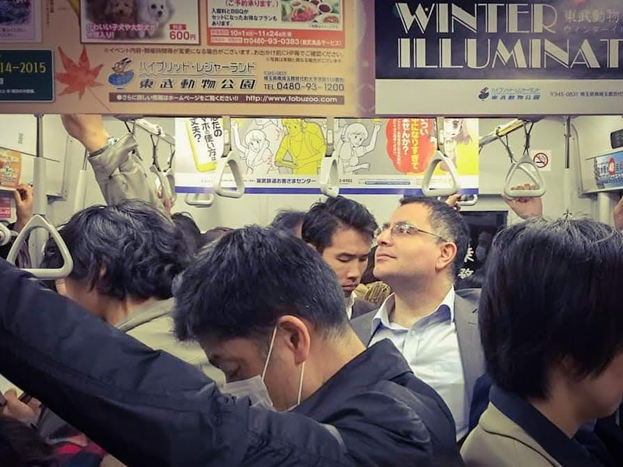 Salarymac: Mac. Founder and Lead Guide of Maction Planet, in his salryman days on a crowded Tokyo train