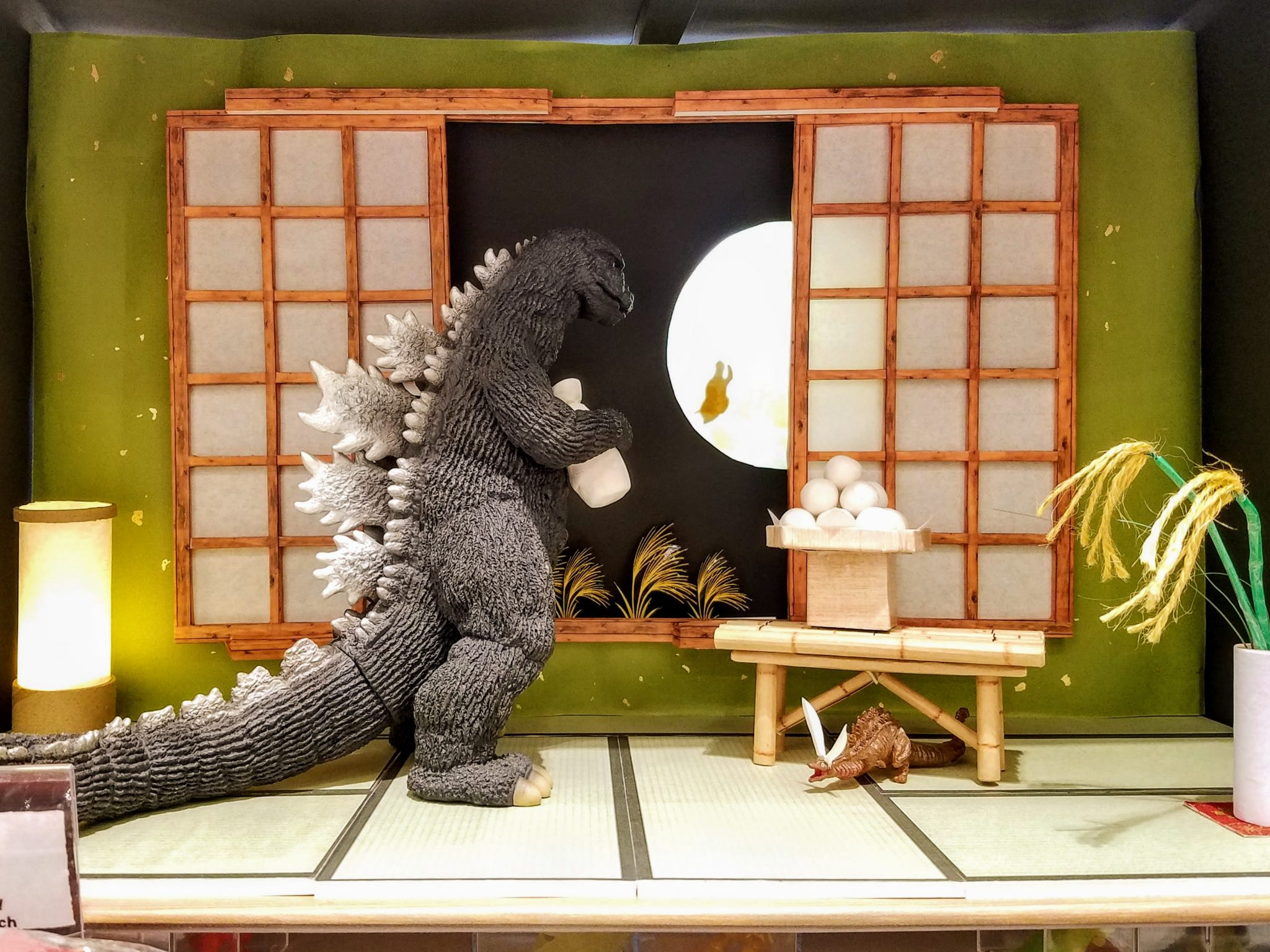 Godzilla enjoying a moon-viewing (tsukimi) party at the Godzilla Store in Tokyo