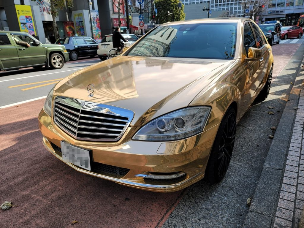 Gold Mercedes parked by Shibuya Crossing in Tokyo
