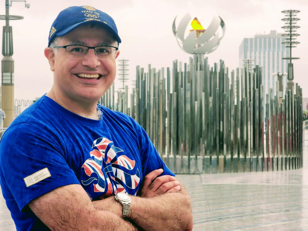 Mac, founder and lead guide of Maction Planet with the Tokyo 2020 Olympic flame