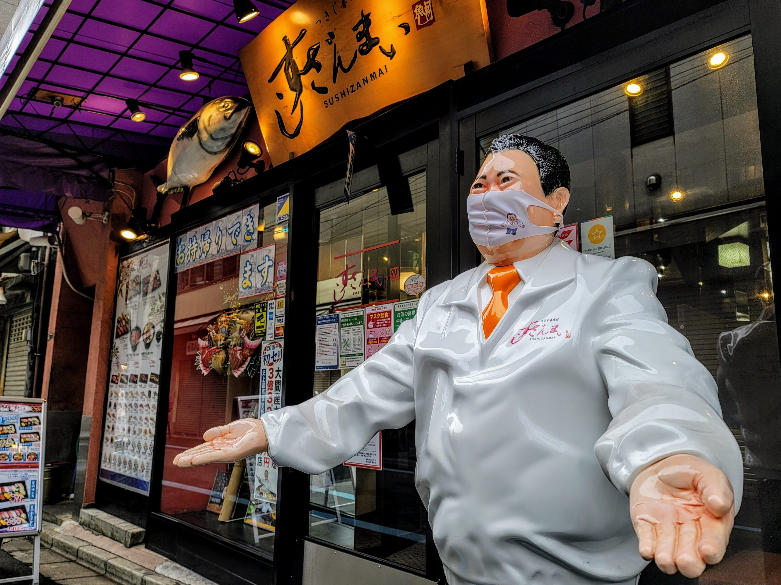 The first sushizanmai in Tsukiji with the founder wearing a mask